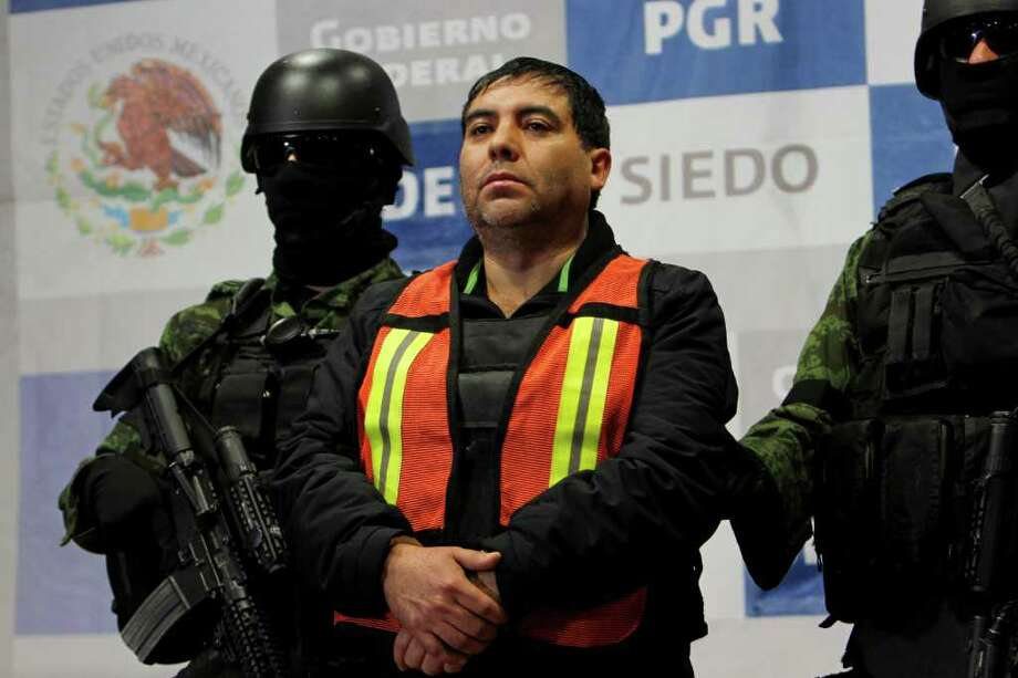 "Felipe Cabrera Sarabia, alias ""El Inge,"" is shown to the press under the custody of army soldiers at the federal organized crime investigations headquarters (SIEDO) in Mexico City, Monday Dec. 26, 2011. According to federal authorities, Sarabia is a close associate and head of security for Mexico's most wanted criminal, Joaquin Guzman Loera, alias ""El Chapo,"" leader of the Sinaloa cartel in the Durango mountains region.   Authorities say Sarabia was captured on Friday in the capital of Sinaloa state. Photo: AP"