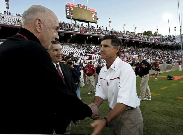 Stanford football coach Walt Harris, right, shakes hands with Stanford fan John Arrillaga, left, a developer, as new Stanford athletic director Bob Bowlsby, center, looks on in Stanford's newly renovated stadium before Stanford's college football game against Navy, Saturday, Sept. 16, 2006, in Stanford, Calif. Arrillaga help pay for the new stadium. (AP Photo/Paul Sakuma) Photo: Paul Sakuma, ASSOCIATED PRESS