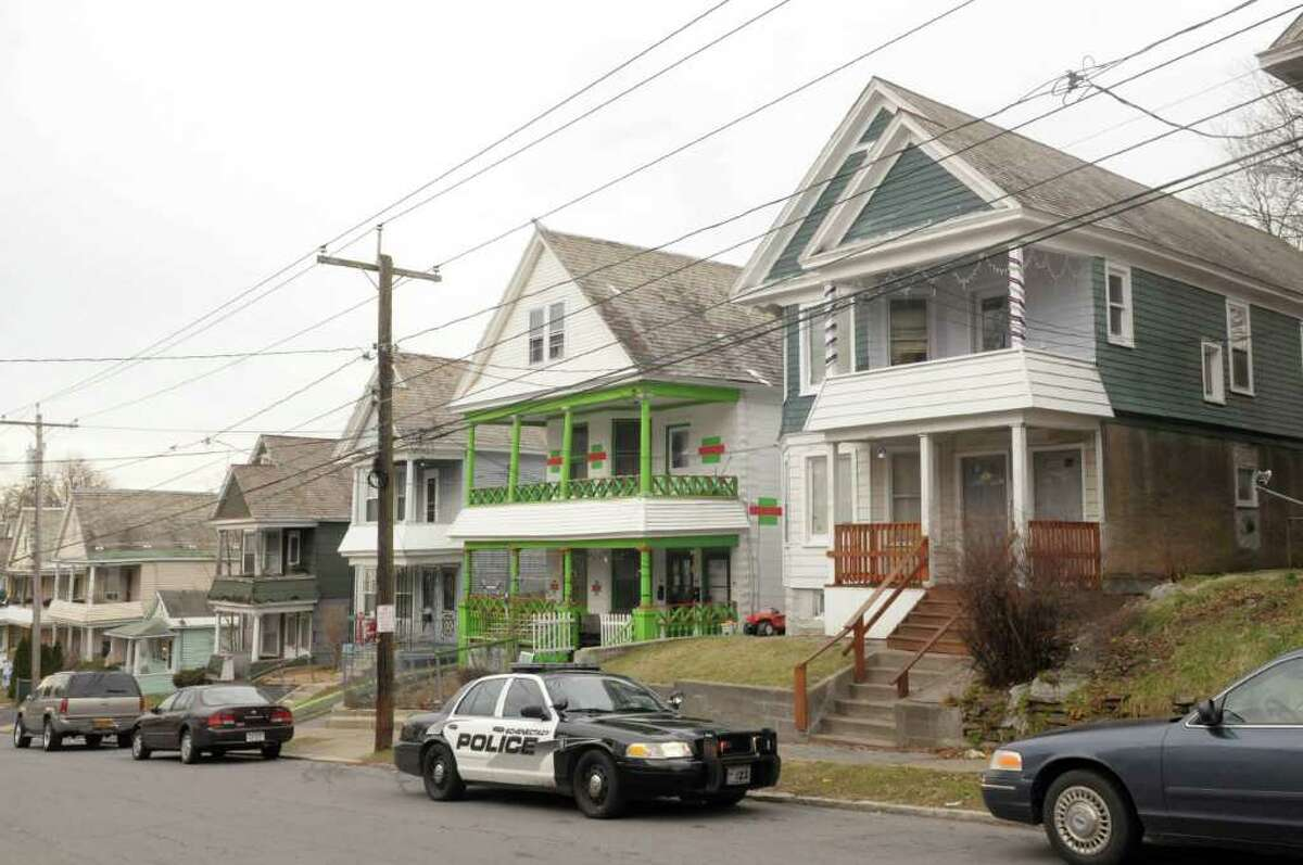 A view of the apartments at 201 and 203 Elm St., far right in photo, on Tuesday, Dec. 27, 2011 in Schenectady, NY. (Paul Buckowski / Times Union)