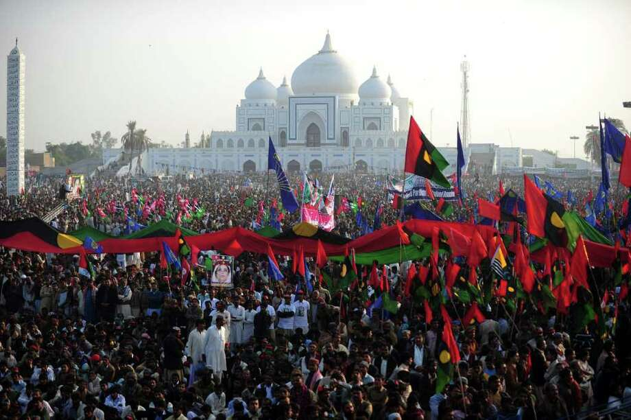 "A gathered crowd listens to Pakistani President Asif Ali Zardari, widower of assassinated former premier Benazir Bhutto, outside the Bhutto mausoleum on her fourth death anniversary in Garhi Khuda Bakhsh on December 27, 2011. Pakistan's embattled president vigorously defended his rule and urged the nation to foil ""conspiracies against democracy"" on the anniversary of his wife Benazir Bhutto's murder. AFP PHOTO / ASIF HASSAN Photo: ASIF HASSAN, Getty / AFP"