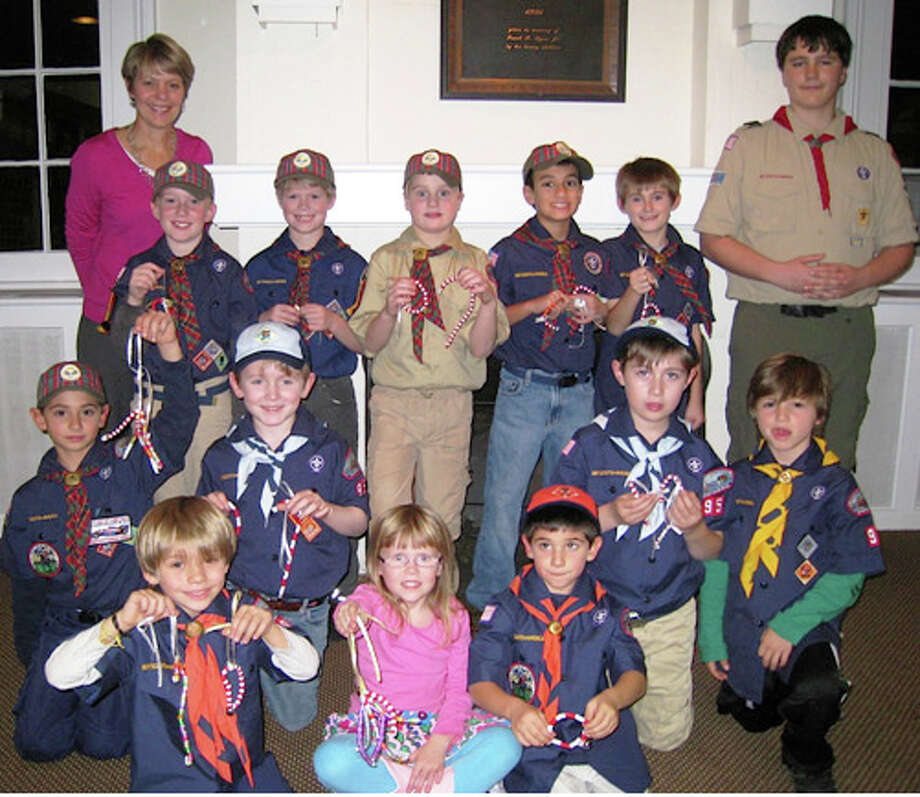 Shown with the scouts are Kim Kristof, coordinator of development at the agency and Warren Hurlock who assists with troop activities. Photo: Contributed Photo