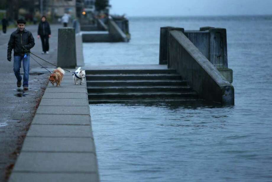 "A ""king tide"" reaches its peak at Seattle's Alki Beach on Tuesday, December 27, 2011. King tides are a natural phenomenon that occur once or twice a year when the sun and moon's gravitational pulls reinforce one another. They happen when the moon is closest to the earth. Photo: JOSHUA TRUJILLO / SEATTLEPI.COM"
