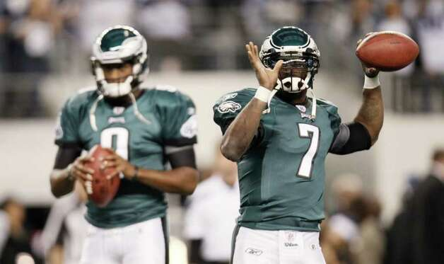 Philadelphia Eagles quarterback Vince Young (9) and quarterback Michael Vick (7) before an NFL football game Saturday, Dec. 24, 2011, in Arlington, Texas. (AP Photo/Brandon Wade) Photo: Brandon Wade, Associated Press / FR168019 AP
