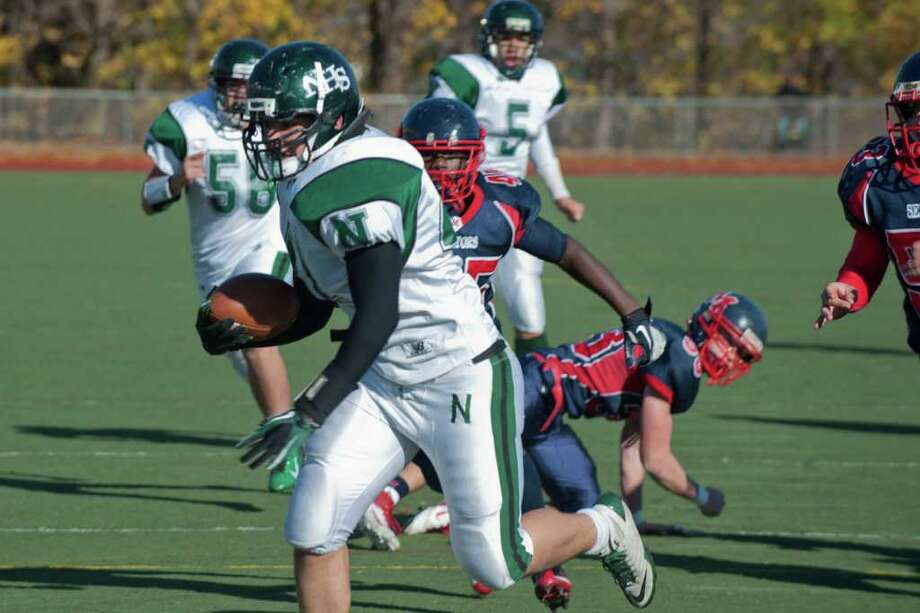Norwalk's Gil Araujo rushes to the end zone during high school football action, at Brien McMahon, Thursday Nov. 24, 2011. Photo: Douglas Healey / Stamford Advocate