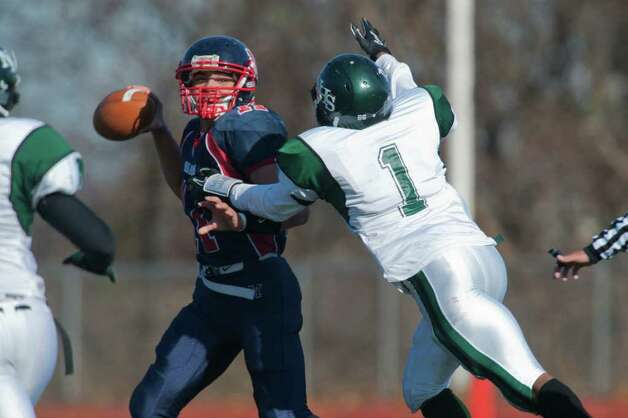 Norwalk's Bobby Stringfellow breaks up a play against Brien McMahon QB Damien Vega during high school football action, at Brien McMahon, Thursday Nov. 24, 2011. Photo: Douglas Healey / Stamford Advocate