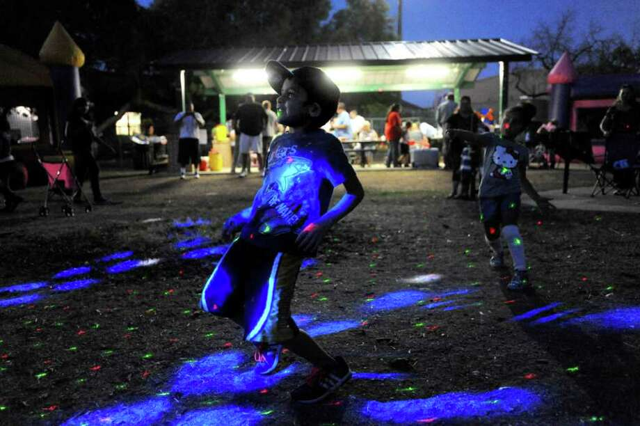 Jeremy Duran, 6, dances during the Harlandale Park Neighborhood Association National Night Out event on Tuesday October 4, 2011 at Harlandale Park. Photo: BILLY CALZADA, Billy Calzada / gcalzada@express-news.net