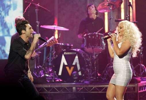 Adam Levine, left, the band Maroon 5, and Christina Aguilera perform at the 39th Annual American Music Awards on Sunday, Nov. 20, 2011 in Los Angeles. (AP Photo/Matt Sayles) Photo: Matt Sayles, STF / AP