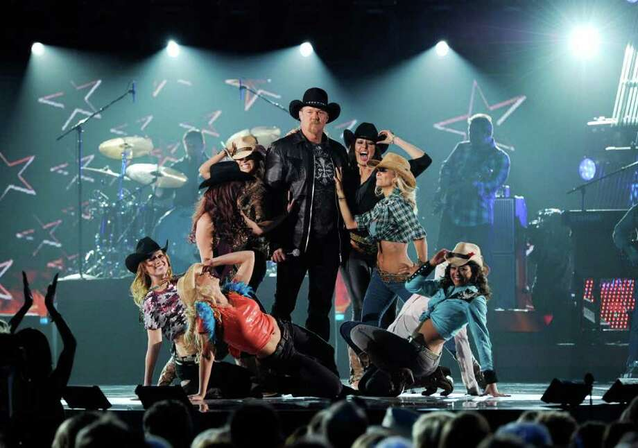 LAS VEGAS, NV - DECEMBER 05:  Host Trace Adkins speaks onstage at the American Country Awards 2011 at the MGM Grand Garden Arena on December 5, 2011 in Las Vegas, Nevada.  (Photo by Ethan Miller/Getty Images) Photo: Ethan Miller, Staff / 2011 Getty Images