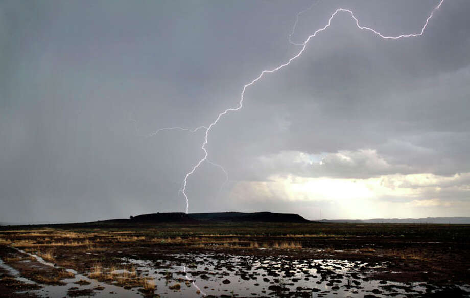 A lightning bolt strikes ground east of Fort Davis during a late afternoon thunderstorm, 