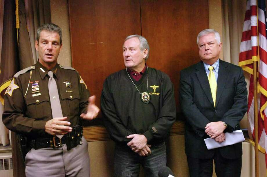 Allen County Sheriff Ken Fries, left, Allen County Coroner Jon Brandenberger, M.D., center, and Allen County Chief Deputy Prosecutor Michael McAlexander hold a press briefing on the Alihana Lemmon case in the Allen County Sheriff's office Tuesday Dec. 27, 2011 in Fort Wayne, Ind. The Allen County Sheriff's Department says in an affidavit that babysitter Michael Plumadore, 39, admits he killed Aliahna Lemmon on Dec. 22.  Police say a Plumadore bludgeoned the 9-year-old to death with a brick then dismembered her with a hacksaw.  (AP Photo/The Journal Gazette, Cathie Rowand) Photo: Cathie Rowand, Associated Press / The Journal Gazette