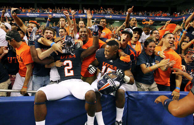 UTSA's Jeremy Hall (left) and teammate Josiah Monroe celebrate with fans after the game with Northeastern State Saturday Sept. 3, 2011 at the Alamodome. UTSA won 31-3. Photo: EDWARD A. ORNELAS, Edward A. Ornelas / SAN ANTONIO EXPRESS-NEWS (NFS)