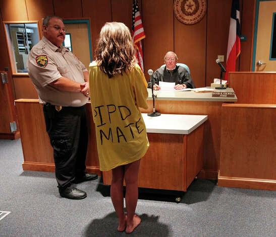 A 19-year-old female spring breaker talks with Municipal Judge David K. Colwell after spending the night in jail for public intoxication Tuesday March 15, 2011 on South Padre Island, Tx. She pleaded no contest was fined $265.00 and ordered to complete an alcohol awareness course. Photo: EDWARD A. ORNELAS, Edward A. Ornelas / SAN ANTONIO EXPRESS-NEWS NFS