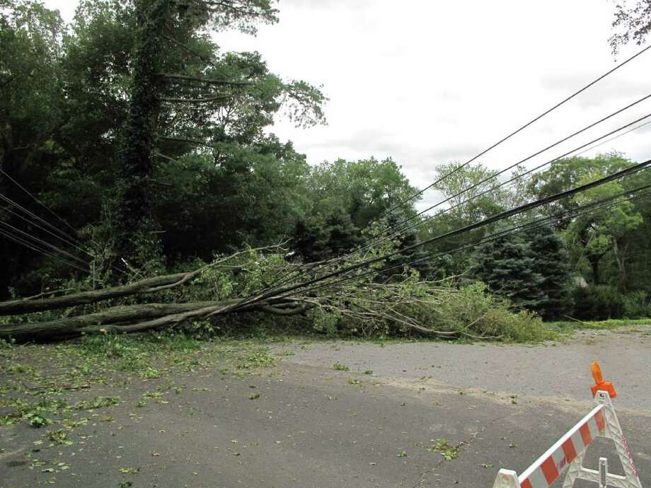 Several trees down on wires near the New Canaan/Darien border on Hollow Tree Ridge Road after Tropical Storm Irene in September. Photo: Paresh Jha