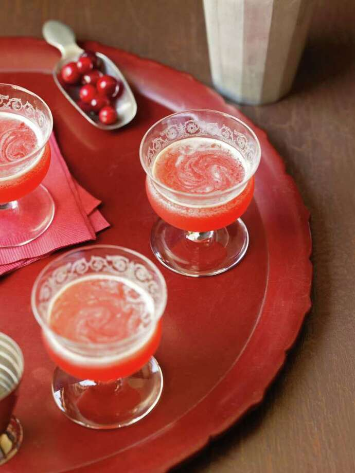 Bourbon BogThis drink takes little time to make, and it's a fantastic cocktail to serve at any holiday party since it is light and fruity. The chilled drink will still cause your guest's cheek to turn rosy with warmth because of the alcohol.  Photo: Chronicle Books