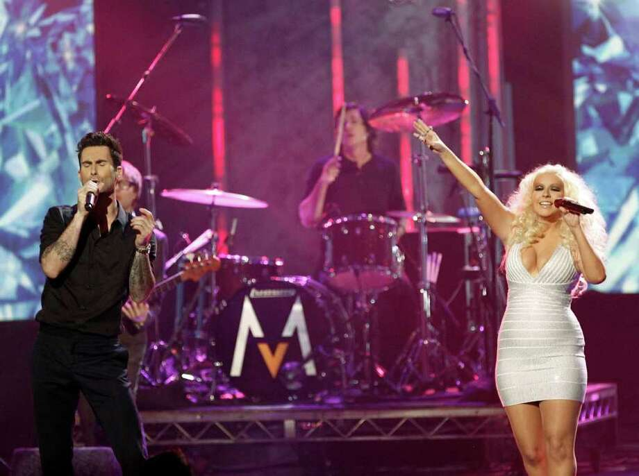 Adam Levine, left, the band Maroon 5, and Christina Aguilera perform at the 39th Annual American Music Awards on Sunday, Nov. 20, 2011 in Los Angeles. (AP Photo/Matt Sayles) Photo: Matt Sayles / AP