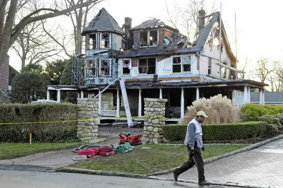 Stamford - CT - 12/25/11 - The three-alarm fire that broke out in this home at 2267 Shippan Avenue in Stamford at approximately  5:00 A.M. Christmas morning, killed two adults and three children inside. BETTINA HANSEN | bhansen@courant.com ORG XMIT: - Photo: Hartford Courant\Bettina Hansen / Connecticut Post Contributed