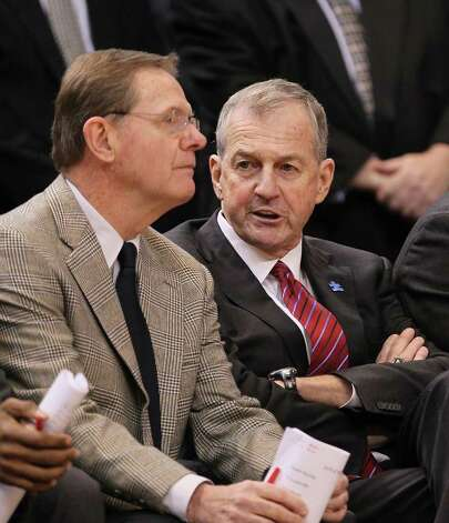 UConn basketball coach Jim Calhoun with assistant coach George Blaney during a game against the Cincinnati Bearcats at the XL Center on February 13, 2010 in Hartford, Conn. The NCAA Committee on Infractions found that Calhoun failed to promote an atmosphere of compliance during the recruitment of Nate Miles and suspended him for the first three Big East games next season. Photo: Jim Rogash/Getty Images / 2010 Getty Images