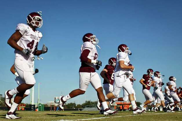Texas A&M players warm up before the start of their practice at the Methodist Training Center at Reliant Park, Tuesday, Dec. 27, 2011, in Houston. Texas A&M will take on Northwestern in the Meineke Car Care Bowl of Texas. Photo: Michael Paulsen, Houston Chronicle / © 2011 Houston Chronicle