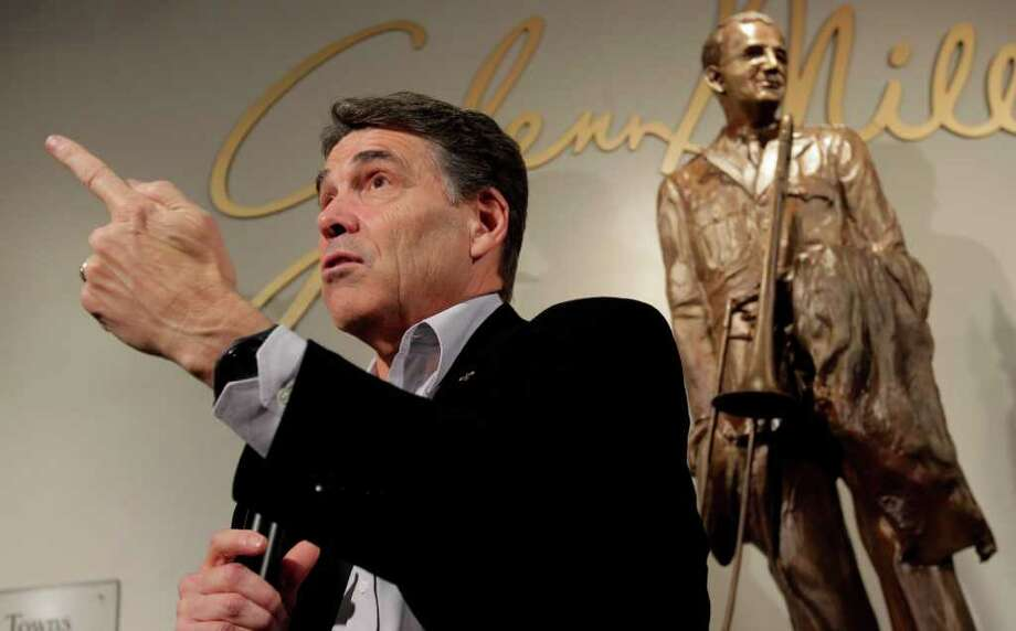 Republican presidential candidate, Texas Gov. Rick Perry answers questions during a campaign stop at the Glenn Miller Museum in Clarinda, Iowa, Tuesday, Dec. 27, 2011. Photo: AP