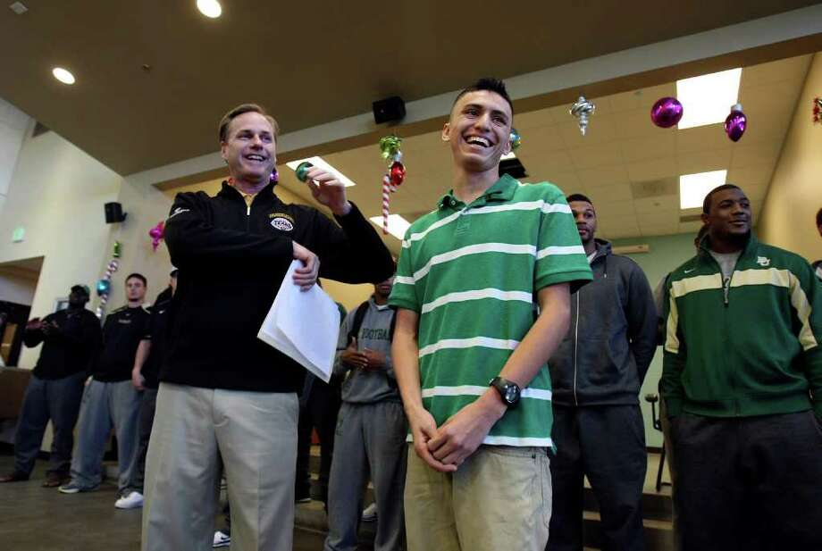 Jerry Haag Baylor's Vice President for University Development speaks with Alejandro Gonzalez, 17, at Haven for Hope on Dec. 27, 2011.  Gonzalez is the first from Haven for Hope to be accepted into college and will be attending Baylor in the fall. Photo: HELEN L. MONTOYA, San Antonio Express-News / SAN ANTONIO EXPRESS-NEWS