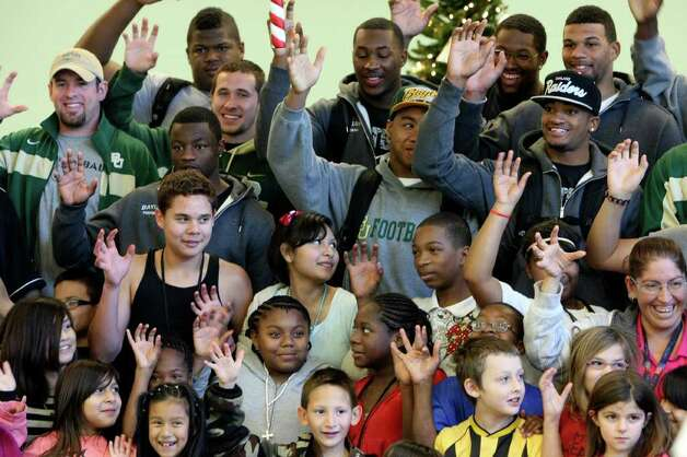 Members of the Baylor Bears football team visited families at Haven for Hope on Dec. 27, 2011. Photo: HELEN L. MONTOYA, San Antonio Express-News / SAN ANTONIO EXPRESS-NEWS