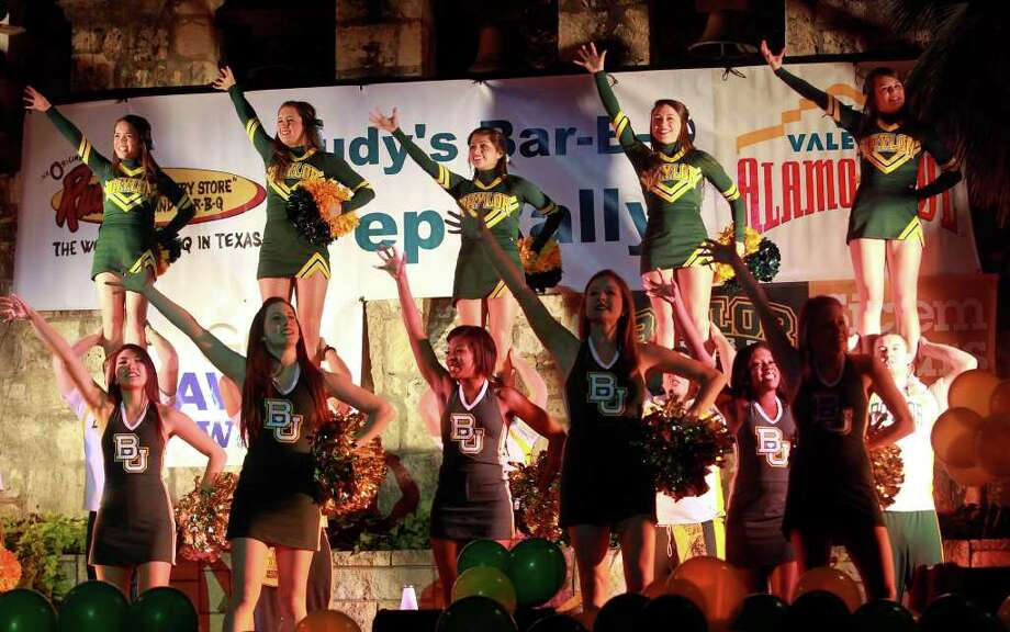 Baylor cheerleaders perform at the Rudy's Bar-B-Q Pep Rally at the Arneson River Theater on the River Walk  on December 27, 2011. Photo: TOM REEL, SAN ANTONIO EXPRESS-NEWS / © 2011 San Antonio Express-News