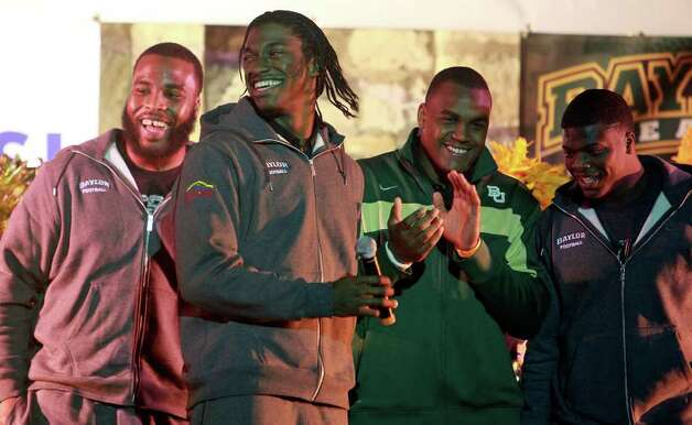 R.G. Griffin III has some fun on stage at the Rudy's Bar-B-Q Pep Rally at the Arneson River Theater on the River Walk  on December 27, 2011. Photo: TOM REEL, SAN ANTONIO EXPRESS-NEWS / © 2011 San Antonio Express-News