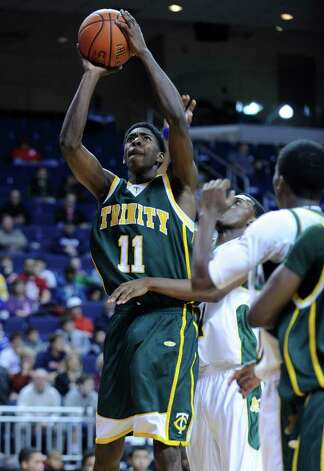Trinity Catholic High School takes on New London Tuesday, December 27, 2011 in the Northeast Classic boys basketball tournament at the Webster Bank Arena in Bridgeport, Conn. Photo: Autumn Driscoll / Connecticut Post