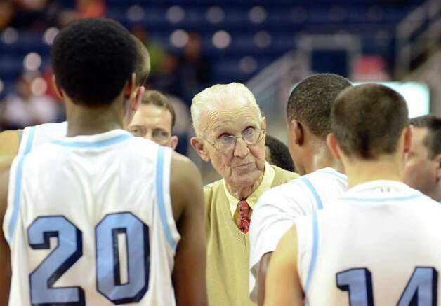 Archbishop Molloy head basketball coach Jack Curran speaks with his team during the boys basketball Northeast Christmas Classic tournament against St. Joseph High School at the Webster Bank Arena in Bridgeport on Tuesday, Dec. 27, 2011. Photo: Amy Mortensen / Connecticut Post Freelance