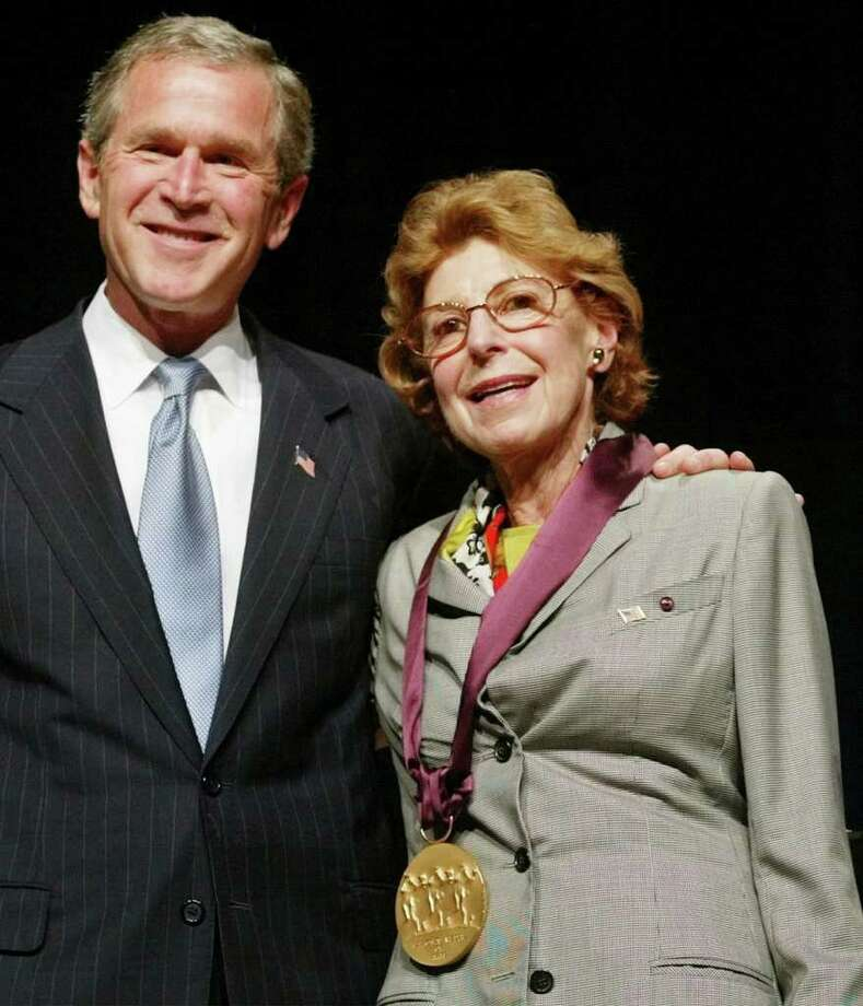 FILE - In this April 22, 2002 file photo, President George W. Bush poses with painter Helen Frankenthaler, from Darien, Conn., during the National Endowment for the Arts National Medal of Arts Awards ceremony at Constitution Hall in Washington. Frankenthaler died Tuesday, Dec. 27, 2011 at her home in Darien. She was 83. (AP Photo/Pablo Martinez Monsivais, File) Photo: Pablo Martinez Monsivais, ASSOCIATED PRESS / AP2002