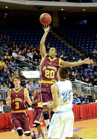 St. Joseph's James Jennings (20) goes up for a shot during the boys basketball Northeast Christmas Classic tournament against Archbishop Molloy High School at the Webster Bank Arena in Bridgeport on Tuesday, Dec. 27, 2011. Photo: Amy Mortensen / Connecticut Post Freelance