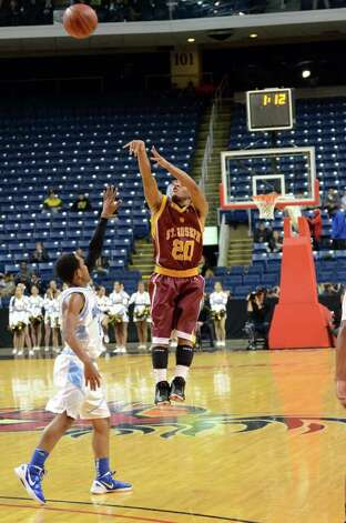 St. Joseph's James Jennings (20) gets some air as he shoots a three-pointer during the boys basketball Northeast Christmas Classic tournament against Archbishop Molloy High School at the Webster Bank Arena in Bridgeport on Tuesday, Dec. 27, 2011. Photo: Amy Mortensen / Connecticut Post Freelance