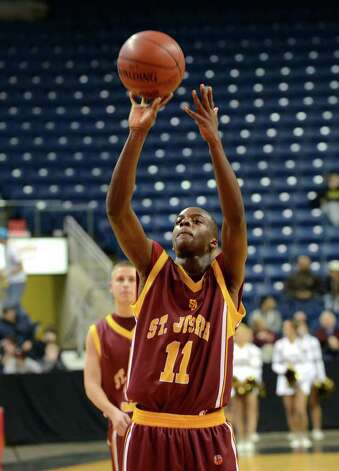 St. Joseph's Quincy McKnight (11) shoots a free throw during the boys basketball Northeast Christmas Classic tournament against Archbishop Molloy High School at the Webster Bank Arena in Bridgeport on Tuesday, Dec. 27, 2011. Photo: Amy Mortensen / Connecticut Post Freelance