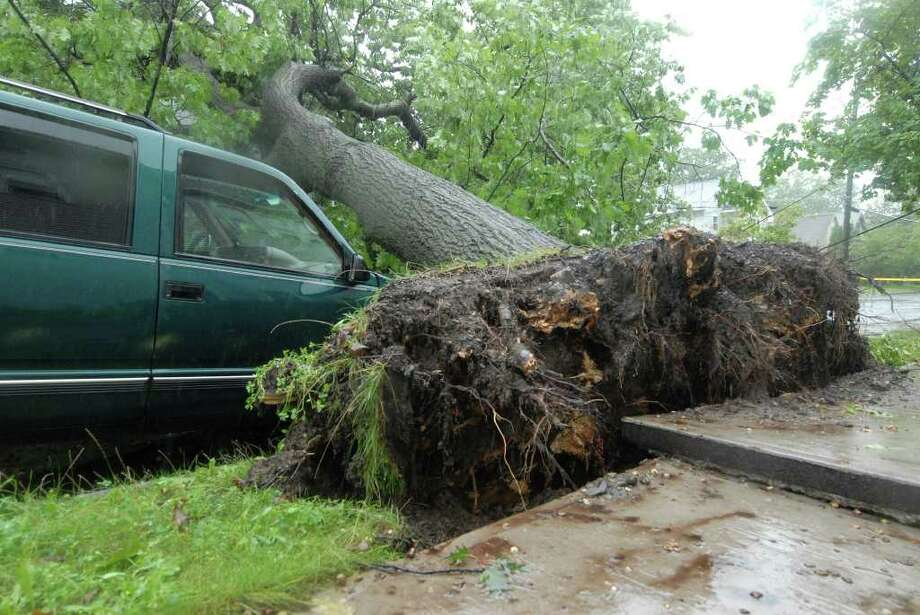 Mereline Ave. in Albany is blocked by a fallen tree Sunday Aug. 28, 2011. Hurricane Irene entered the Capital Region Sunday morning. Emergency personnel spent the day responding to reports of fallen trees, flooding basements, and damaged utility lines. (Will Waldron / Times Union) Photo: Will Waldron