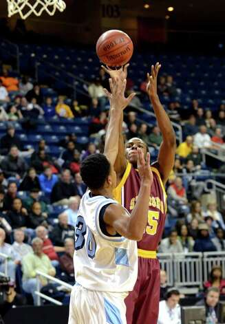 St. Joseph's Timajh Parker (15) takes a shot as Archbishop Molloy's Morrell Gaskins (30) defends during the boys basketball Northeast Christmas Classic tournament against Archbishop Molloy High School at the Webster Bank Arena in Bridgeport on Tuesday, Dec. 27, 2011. Photo: Amy Mortensen / Connecticut Post Freelance