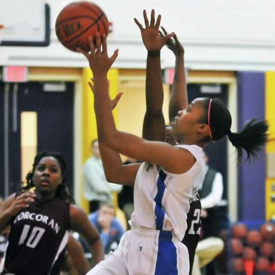 Albany High's #4 Emia Willingham-Hurst drives to the hoop during their tournament game against Corco