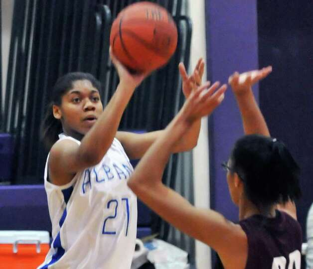 Albany High's #27 Dahnasia Wiiliams, left, shoots during their tournament game against Corcoran High