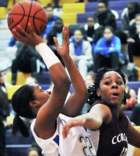 Albany High's #22 India Terrell left, gets a shot past  Corcoran's #10 Jasmine Davis during their to
