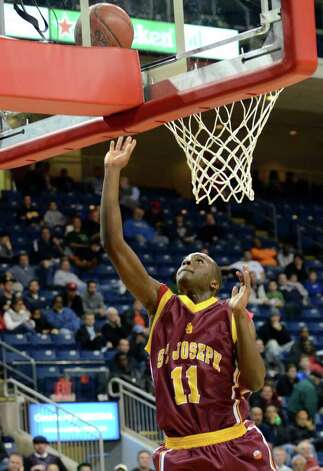 St. Joseph's Quincy McKnight (11) goes up for a shot during the boys basketball Northeast Christmas Classic tournament against Archbishop Molloy High School at the Webster Bank Arena in Bridgeport on Tuesday, Dec. 27, 2011. Photo: Amy Mortensen / Connecticut Post Freelance