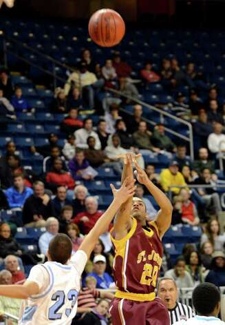 St. Joseph's James Jennings (20) shoots over Archbishop Molloy's Gabriel Kilpatrick (23) during the boys basketball Northeast Christmas Classic tournament against Archbishop Molloy High School at the Webster Bank Arena in Bridgeport on Tuesday, Dec. 27, 2011. Photo: Amy Mortensen / Connecticut Post Freelance