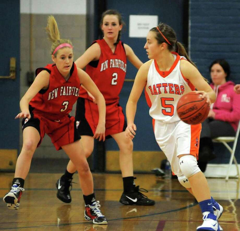 Danbury High School's, Rachel Gartner, has possession of the ball during the 2011 7th Annual Girls Holiday Festival  game against New Fairfield at The Danbury War memorial on Tuesday, Dec. 27. Photo: Lisa Weir / The News-Times Freelance