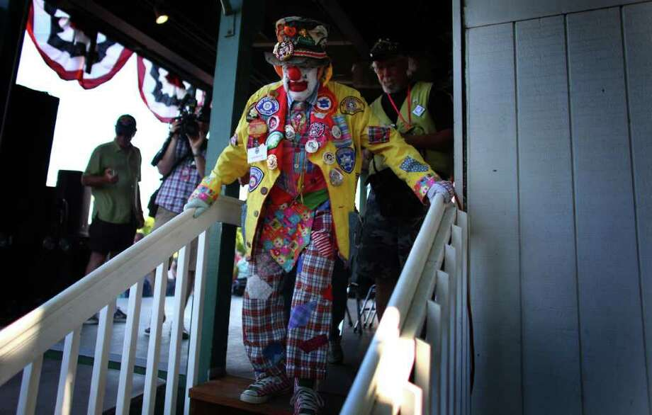Seattle icon J.P. Patches walks off the stage for one of the final times on Saturday, August 27, 2011 at the Evergreen State Fair in Monroe. The appearance by the beloved clown was one of his final performances. The man behind the makeup, Chris Wedes announced his retirement in 2011. Photo: JOSHUA TRUJILLO / SEATTLEPI.COM
