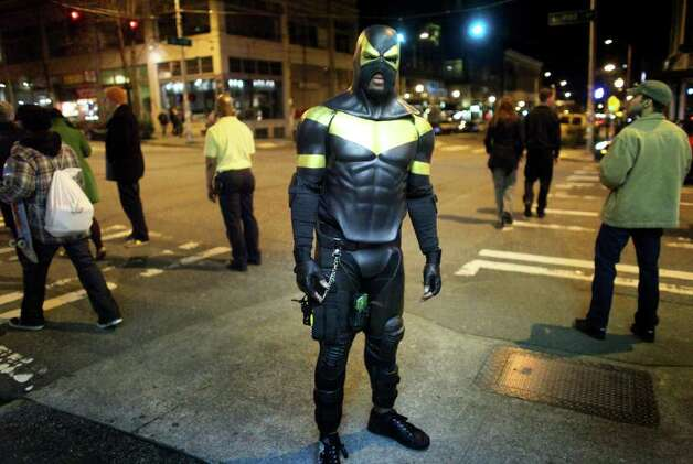 Seattle Superhero Phoenix Jones is shown during one of his patrols on Friday, February 18, 2011in the Capitol Hill neighborhood. The self-proclaimed superhero, who wears body armor, carries pepper spray and an electrified baton, captivated people in the city. He was later arrested for pepper spraying people while attempting to intervene in what he said appeared to be a fight. Charges were never filed against the superhero for the incident. Photo: JOSHUA TRUJILLO / SEATTLEPI.COM