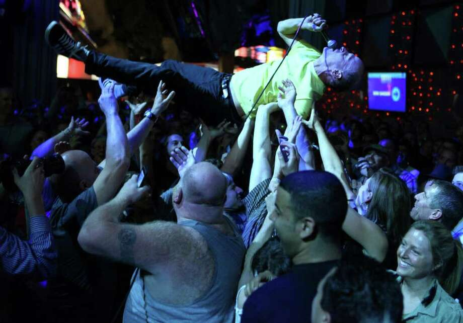 "Chris Ballew, lead singer of Presidents of the United States of America is carried by the crowd as he performs ""On a Plain"" during a Nirvana tribute show and fund raiser on Tuesday, September 20, 2011 at the Experience Music Project in Seattle. The show celebrated the 20th anniversary of Nirvana's album Nevermind and was a fund raiser for Susie Tennant, a Seattle music industry maven diagnosed with cancer. Photo: JOSHUA TRUJILLO / SEATTLEPI.COM"