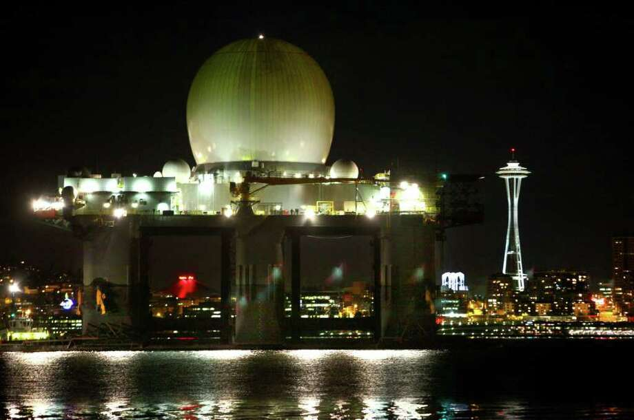 The Missile Defense Agency's Sea-Based X-band Radar (SBX) vessel crosses Elliott Bay and passes in front of Seattle's Space Needle as seen from Alki Beach Tuesday night, May 10, 2011. The SBX is 240 feet wide and 390 feet long and towers more than 280 feet from its keel to the top of the radar dome and displaces nearly 50,000 tons. The main deck is larger than a football field. The towering behemoth became a landmark in Elliott Bay while parked for months at Vigor Shipyard as part of an upgrade and maintenance project. Photo: JOSHUA TRUJILLO / SEATTLEPI.COM