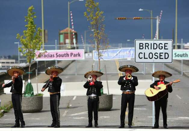 Mariachi Ayutla performs on the old South Park bridge during a celebration kicking off construction of a replacement bridge on Thursday, May 5, 2011 in Seattle's South Park neighborhood. Funding for a replacement was finally approved and construction of the replacement bridge began in 2011. Photo: JOSHUA TRUJILLO / SEATTLEPI.COM