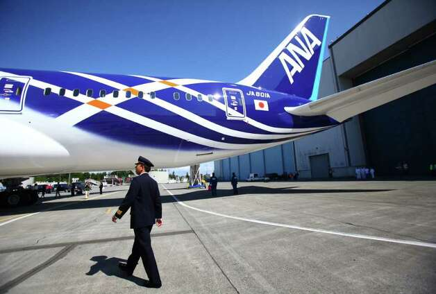 All Nippon Airways pilot Yoshio Taneda does a walk-around during the reveal of the first Boeing 787 destined for use by launch customer All Nippon Airways. The 787 livery and interior were unveiled at the Boeing plant in Everett, Wash. on Saturday, August 6, 2011. The 787 is Boeing's new composite wide-body airliner. Photo: JOSHUA TRUJILLO / SEATTLEPI.COM