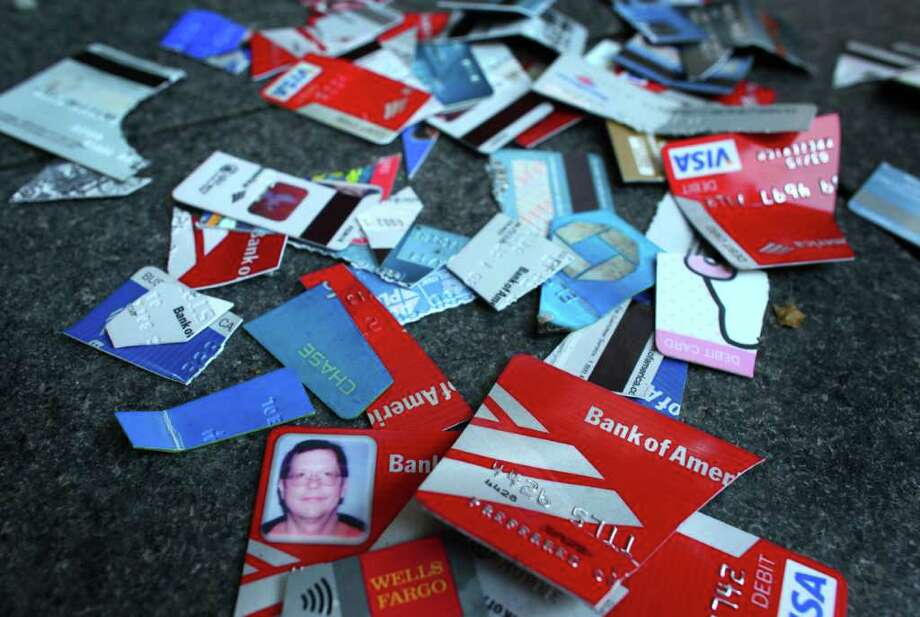 Cut up credit and debit cards are piled in front of the Chase Bank on 4th Avenue on Saturday, October 15, 2011 in Seattle. About 5,000 people joined Occupy Seattle protesters that had been camped at Westlake Park for two weeks. The day was dubbed as a global day of action by the movement. Photo: JOSHUA TRUJILLO / SEATTLEPI.COM