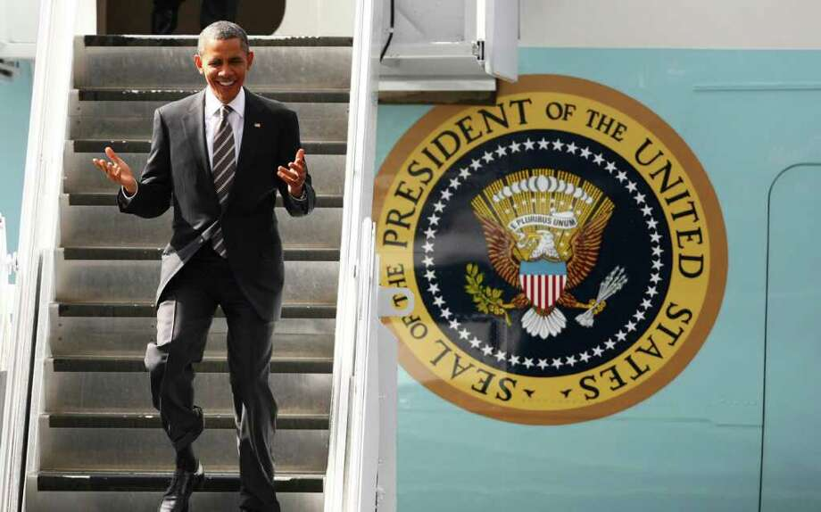 President Barack Obama exits Air Force One at Boeing Field in Seattle during a brief visit to the Seattle-area to raise money for his reelection campaign on Sunday, September 25, 2011. During the visit the President did attend any event open to the general public. Photo: JOSHUA TRUJILLO / SEATTLEPI.COM