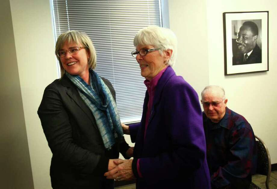 "Major Margaret Witt, who was dismissed from the Air Force under the ""Don't Ask, Don't Tell"" policy, is greeted by her mother Gloria and her father Frank after announcing her settlement with the Air Force on Tuesday, May 10, 2011 at the ACLU of Washington office in Seattle. Witt, a decorated flight nurse, will retire with full benefits and an unlawful discharge will be removed from her record. In 2011 the policy banning homosexuals from the military officially ended. Photo: JOSHUA TRUJILLO / SEATTLEPI.COM"
